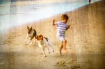 Boy with Beach Buddies, by Al Wood